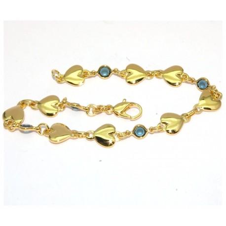 Bracelet plaqué or motifs coeurs et pierres bleues